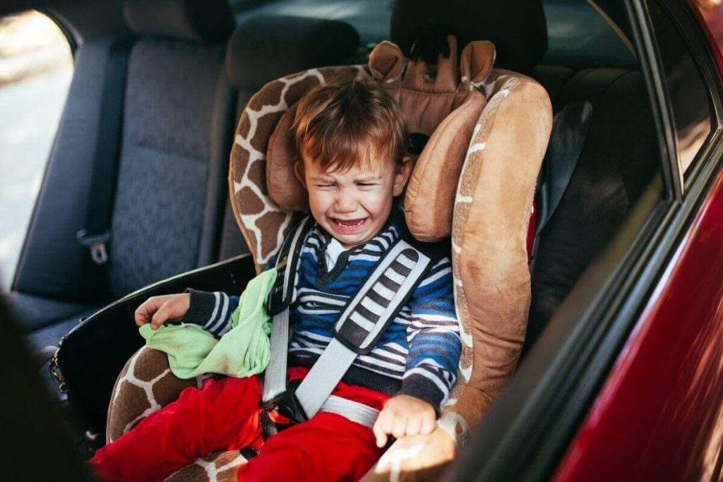 toddler throwing a tantrum in the car seat